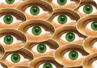 An assortment of green eyes laid over each other