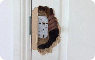 Lex's door with a broken lock inside