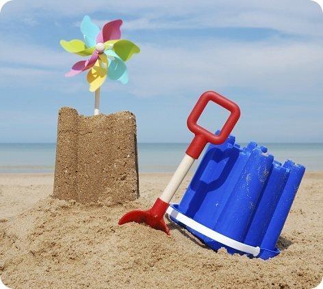 Sandcastle, spade and bucket.